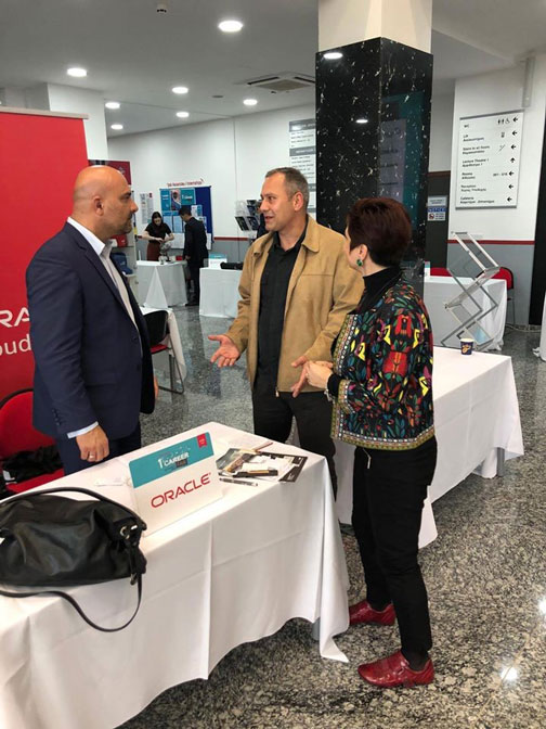 Elena CEO of Go Digital Globally discussing with representative of Oracle